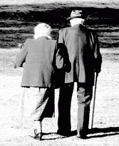 elderly couple walking together in love
